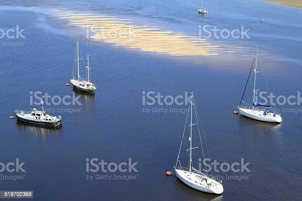 Yacht Moorings In Tidal Estuary Stock Photo - Download Image Now