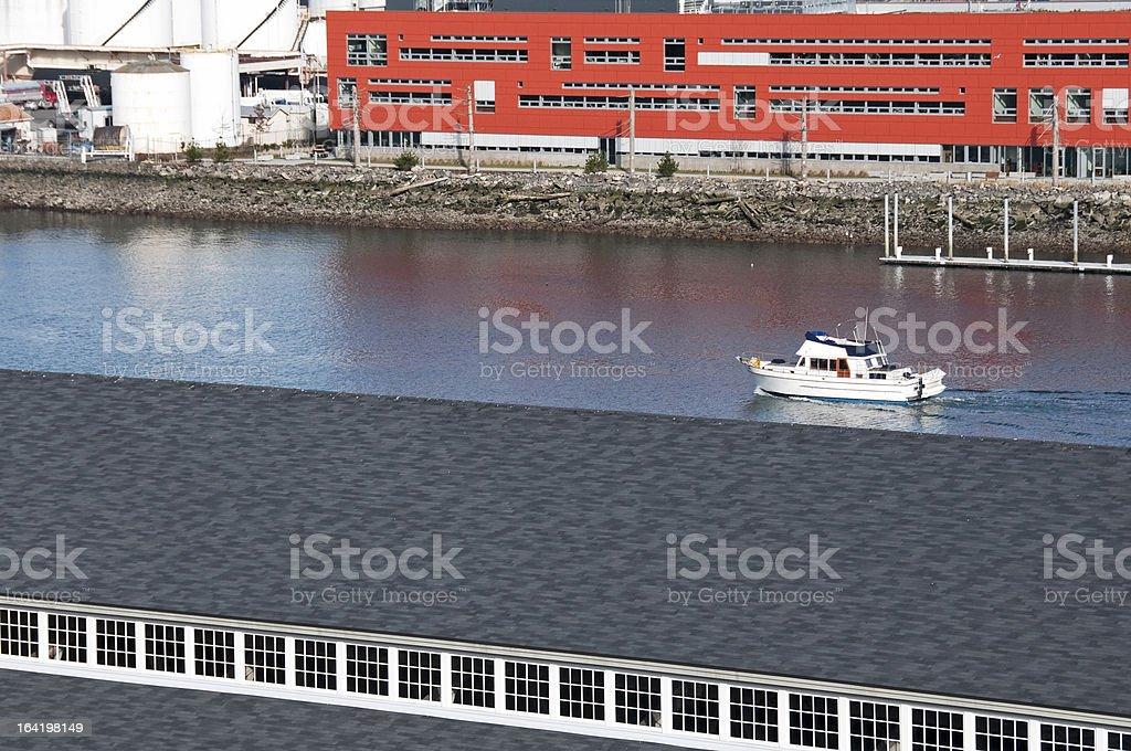 Yacht motoring toward bay on waterway stock photo