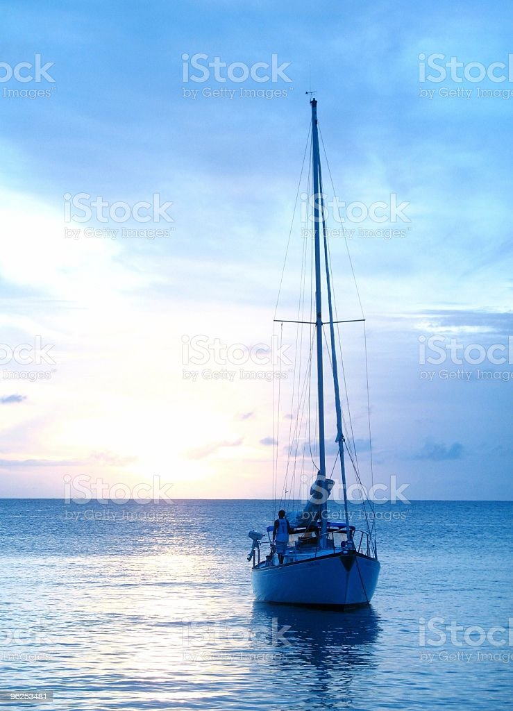 yacht on cool blue water royalty-free stock photo