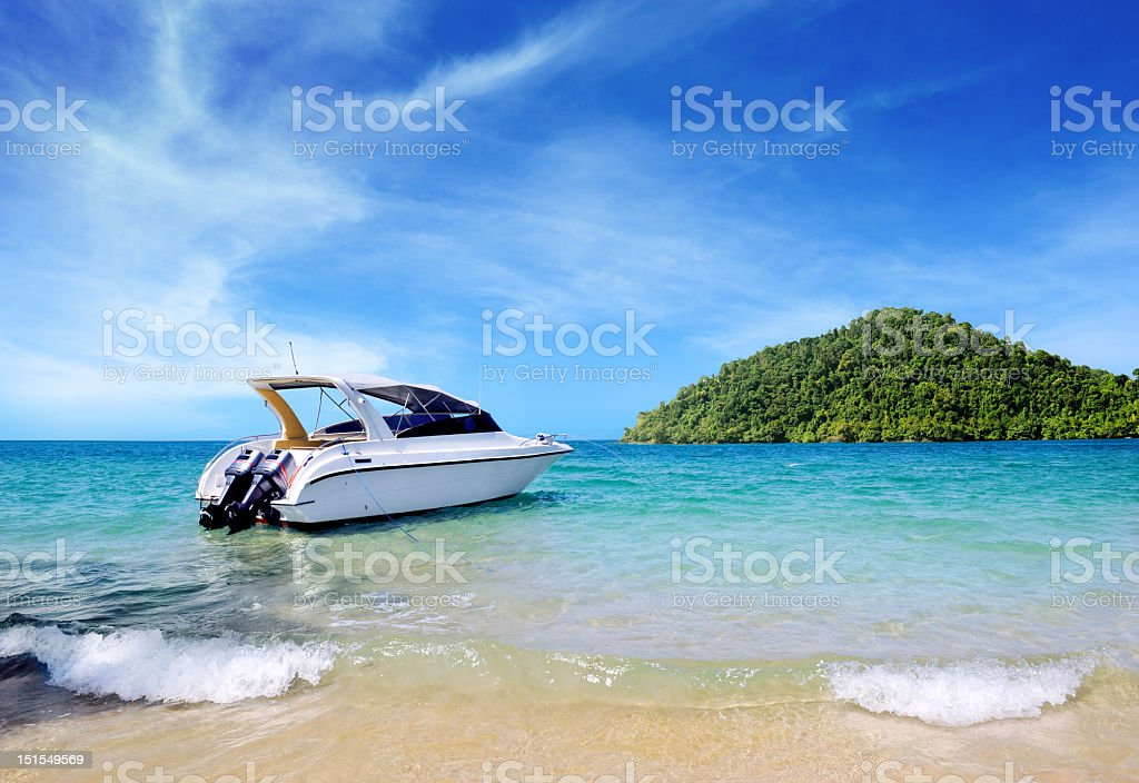 Yacht on the ocean in tropic island stock photo