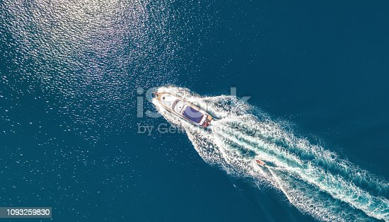1127346848 istock photo Yacht on the sea from top view. Aerail view at the boats. Sea background from top view. Summer seascape from air. Travel concept and idea 1093259830