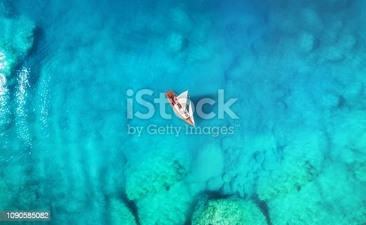 1066331604 istock photo Yacht on the sea from top view. Turquoise water background from top view. Summer seascape from air. Travel concept and idea 1090585082