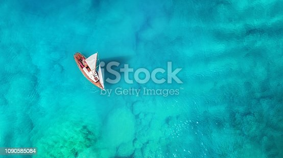 1066331604 istock photo Yacht on the sea from top view. Turquoise water background from top view. Summer seascape from air. Travel concept and idea 1090585084