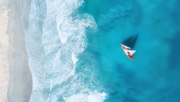 yacht on the water surface from top view. turquoise water background from top view. summer seascape from air. travel concept and idea - sea stock pictures, royalty-free photos & images