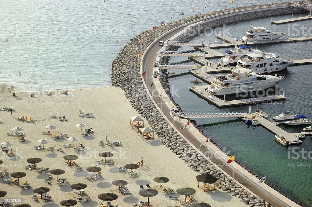 Yacht parking near luxury hotel and beach, Dubai, UAE royalty-free stock photo