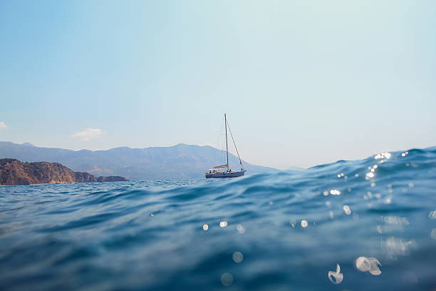 yacht sail in sea with picturesque view - yacht front view stock photos and pictures