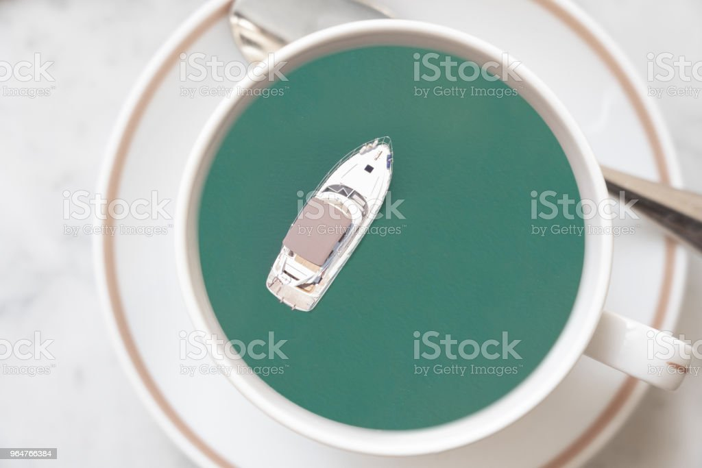 yacht sailing ion the sea in a cup of coffee for travel and relax concept royalty-free stock photo