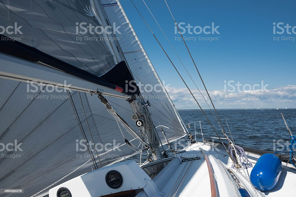 Yacht sailing with full sails stock photo