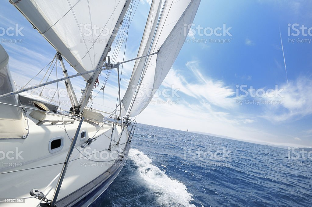 Yacht under sail on the sunny day stock photo