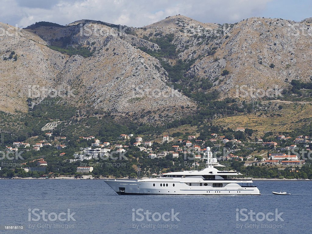 Yacht with Crotia coast in the background stock photo