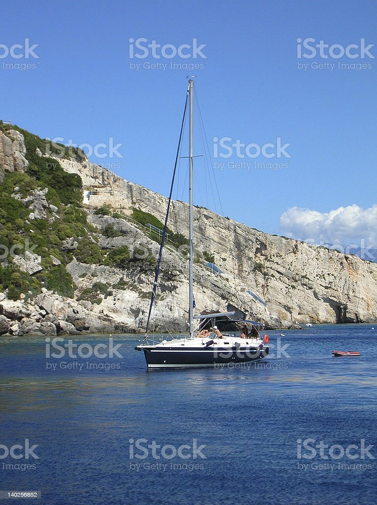 Yacht with tourists on board cruising in the Ionian sea royalty-free stock photo