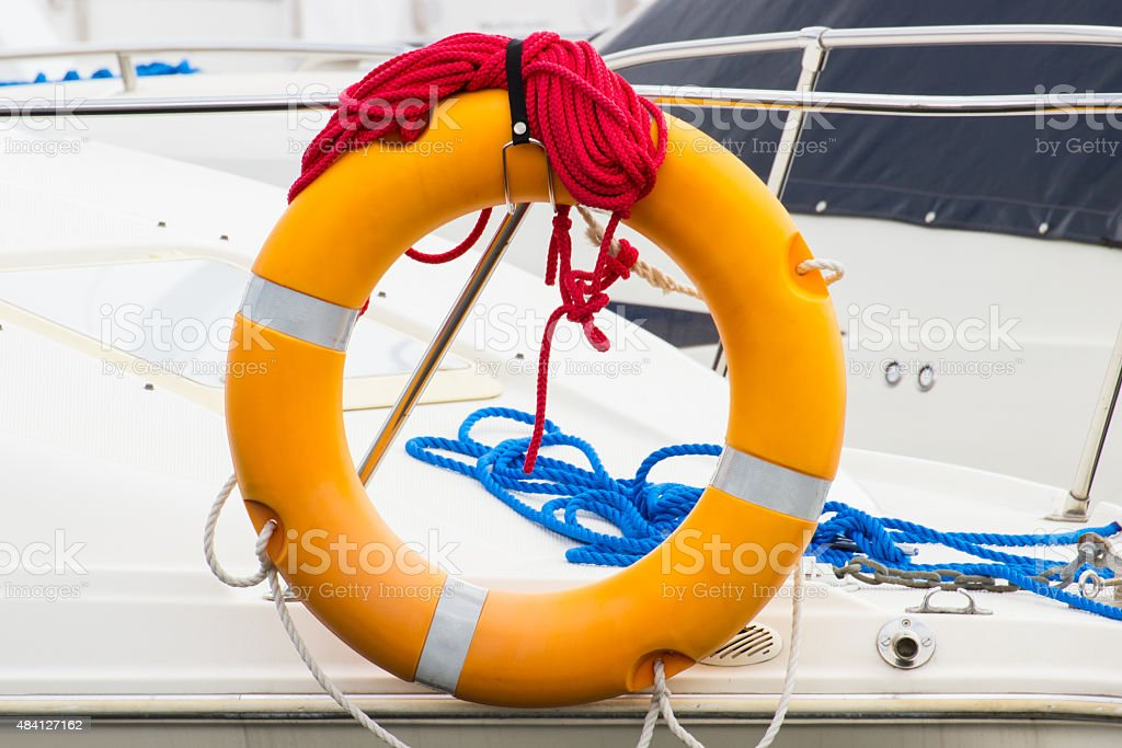Yachting, blue and red rope with orange lifebuoy on sailboat stock photo