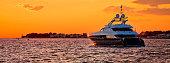 Yachtig on open sea at golden sunset panoramic view, Zadar, Dalmatia, Croatia