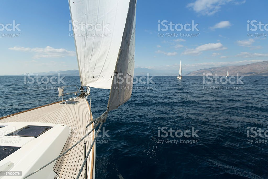 Yachting. Sailing in the wind through the waves. Luxury yachts. stock photo