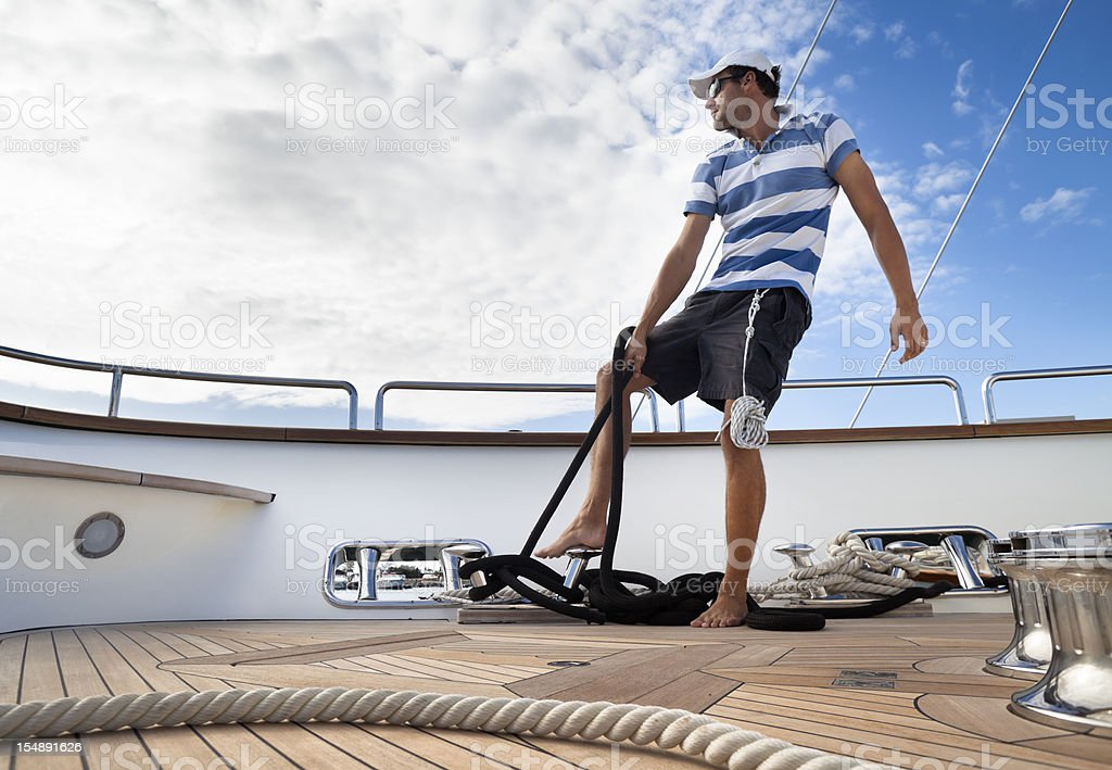 Yachting sport. Tightening the ropes on deck royalty-free stock photo