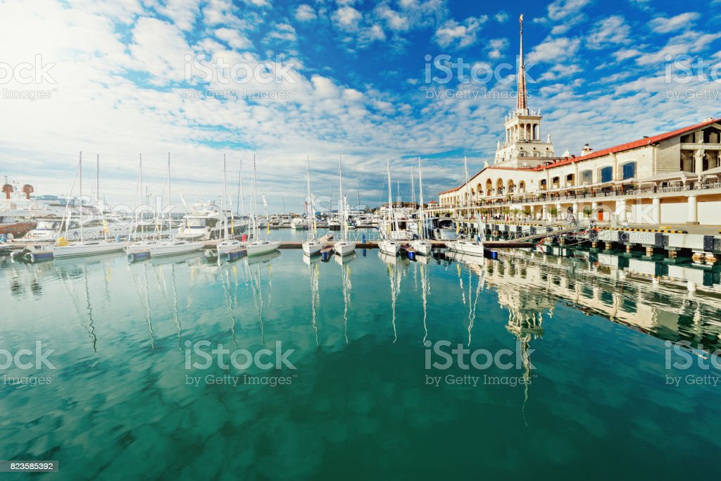 Yachts and boats anchored in the port of Sochi. stock photo