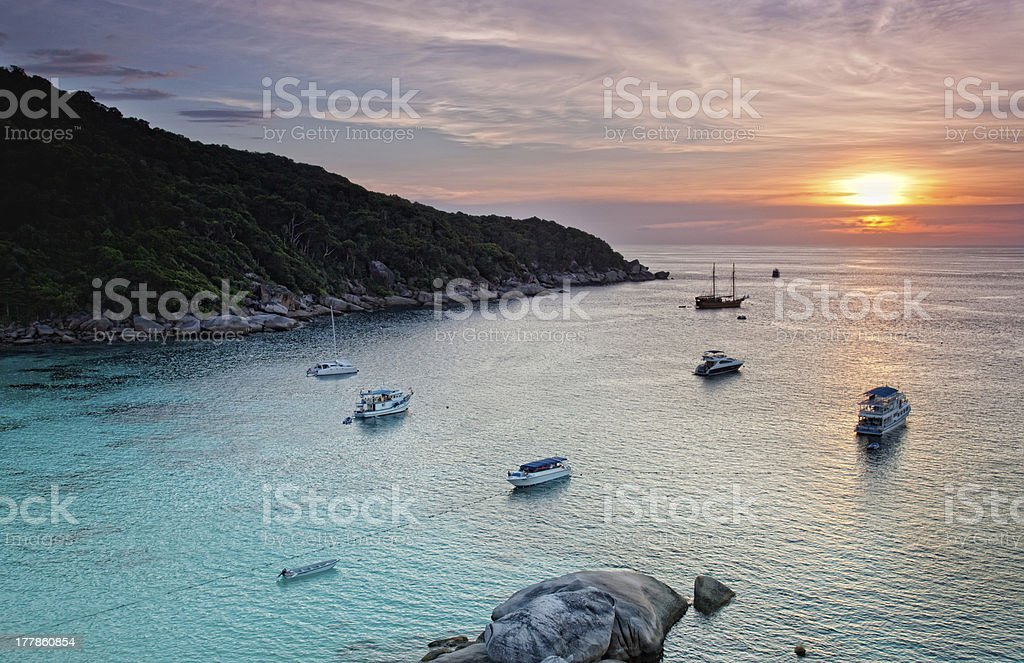 Yachts and boats  in calm Andaman Sea during sunset, Thailand royalty-free stock photo