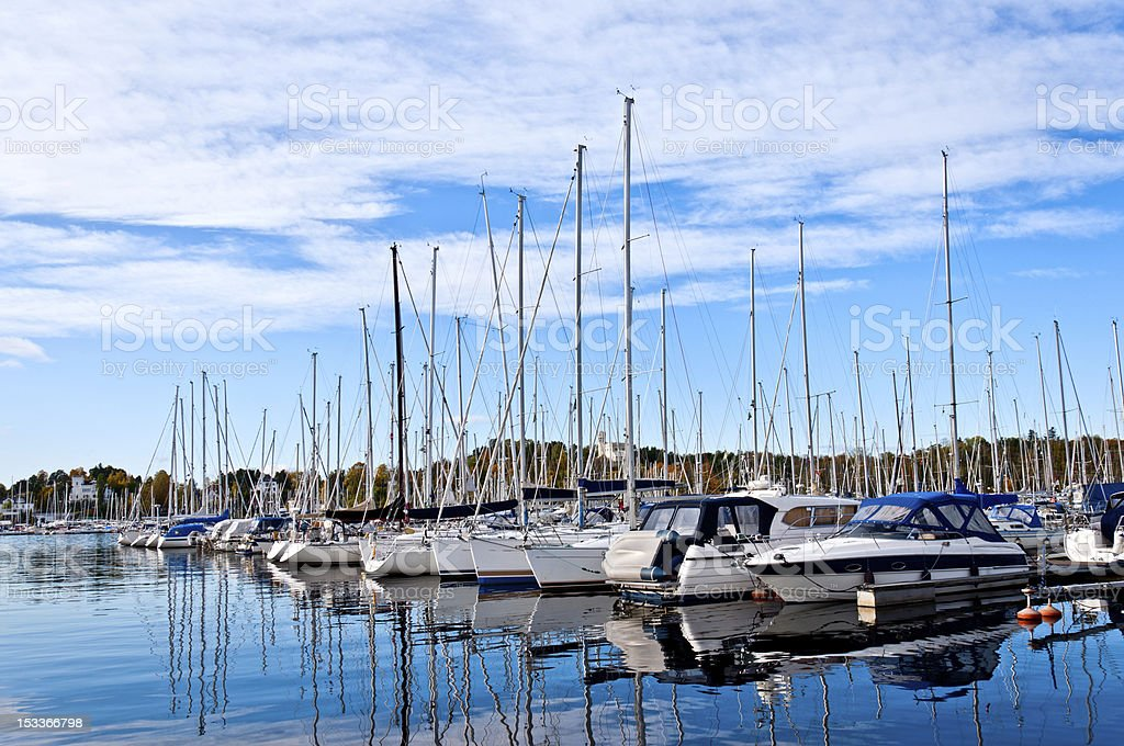 Yachts and boats in the harbor royalty-free stock photo