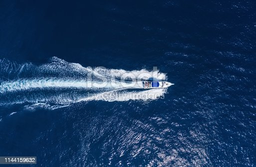 Yachts at the sea in Bali, Indonesia. Aerial view of luxury floating boat on transparent turquoise water at sunny day. Summer seascape from air. Top view from drone. Seascape with motorboat in bay. Travel - image