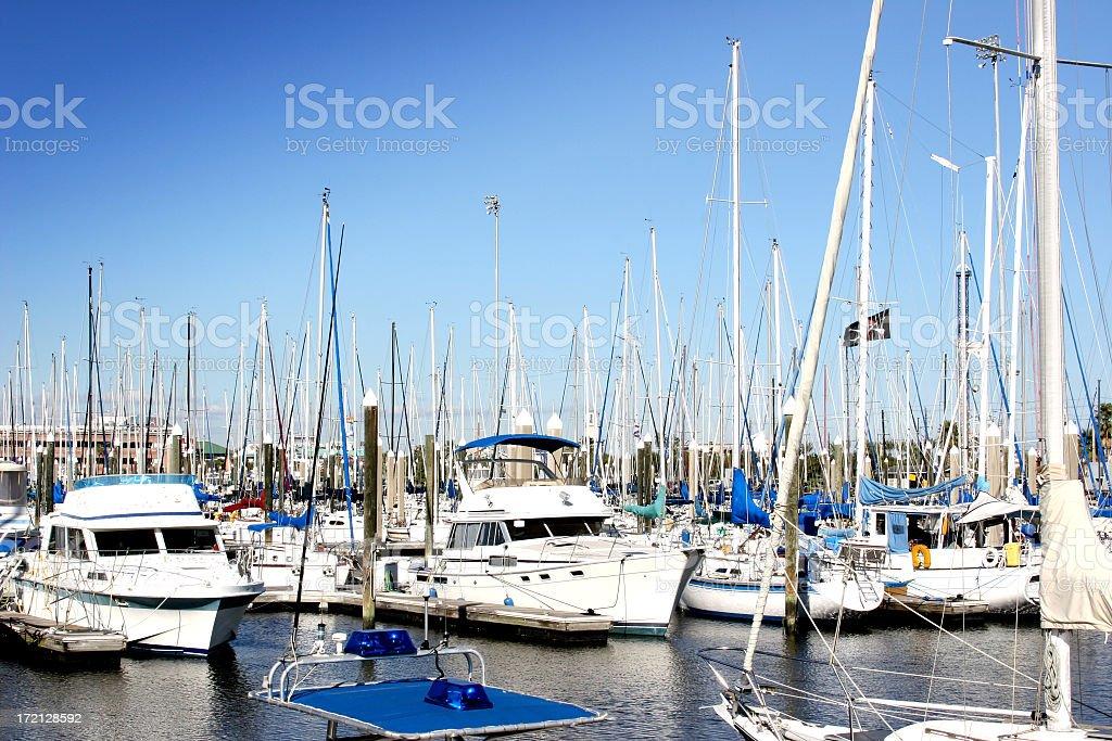 Yachts, boat dock marina. USA coast. Fishing boats. Harbor. Moored. royalty-free stock photo