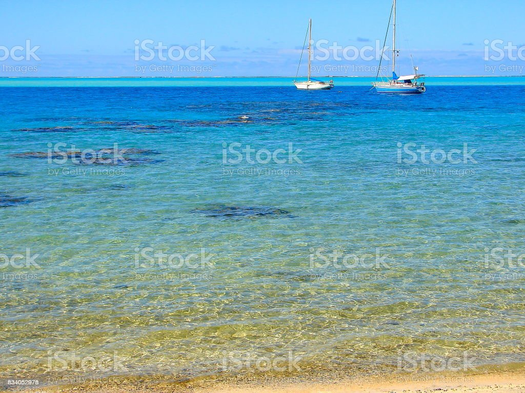 Yachts boats and Polynesian Tropical Summer paradise: dramatic Sandy turquoise tropical beach and translucent water, dreamlike Bora Bora island , Tahiti motus – Idyllic French Polynesia stock photo