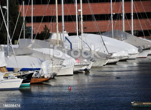 yachts moored and covered for the winter in a marina - photo by M.Torres