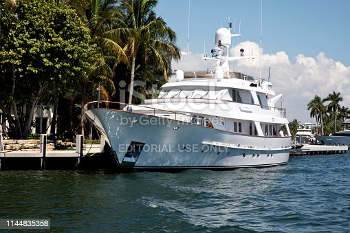 Fort Lauderdale, FL, USA – April 11, 2019: Yachts docked along The Intracoastal Waterway ready to set sail in this vacation wonderland.