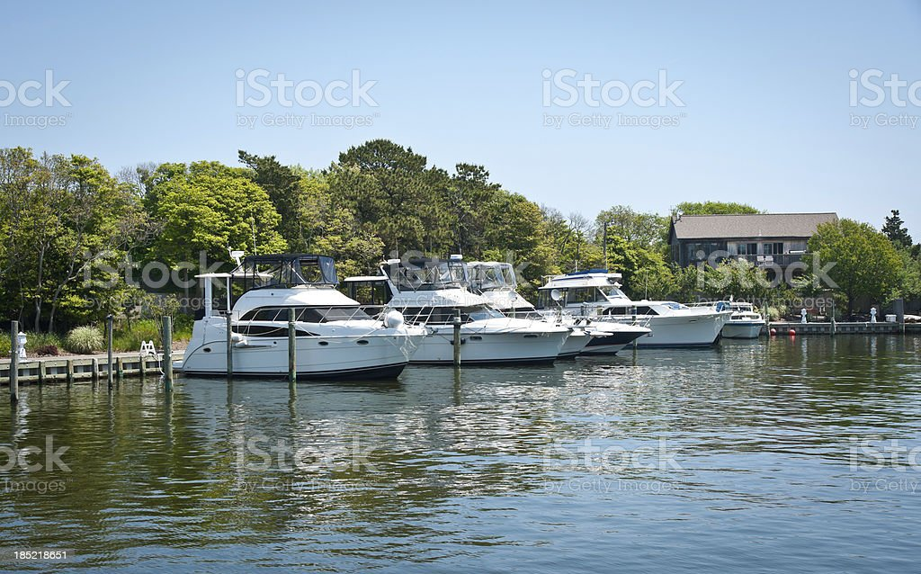 Yachts docked in an island - sunny afternoon stock photo