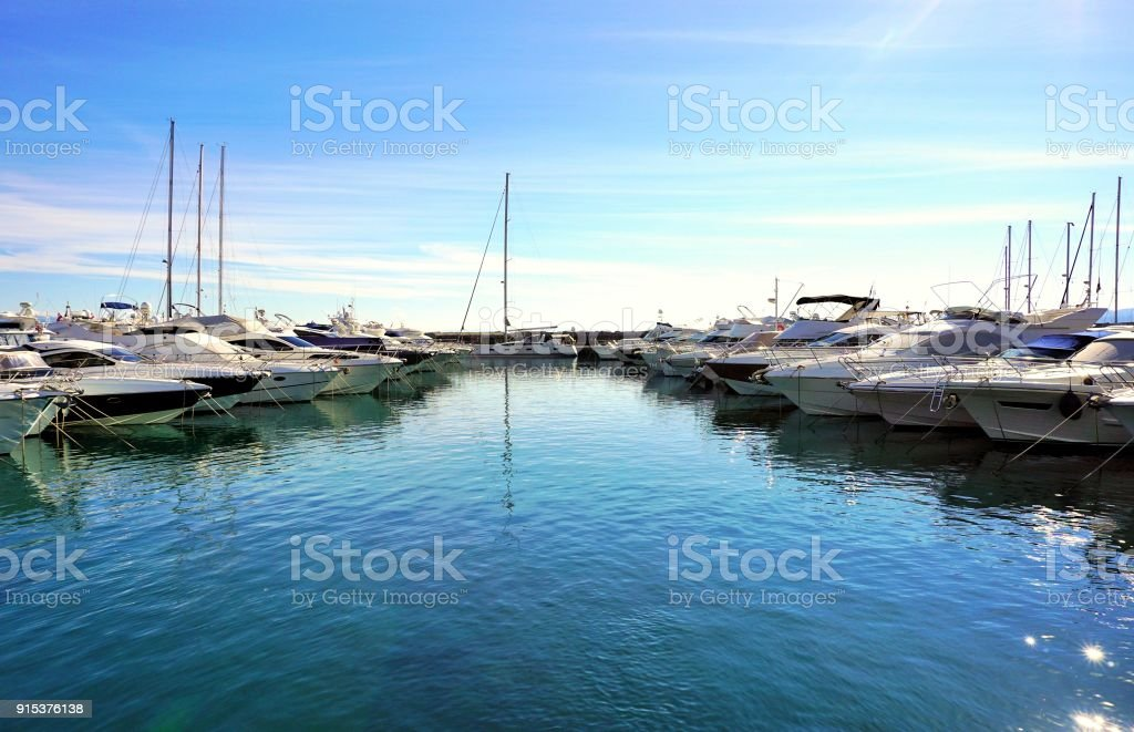 Yachts dropped anchor in seaport stock photo