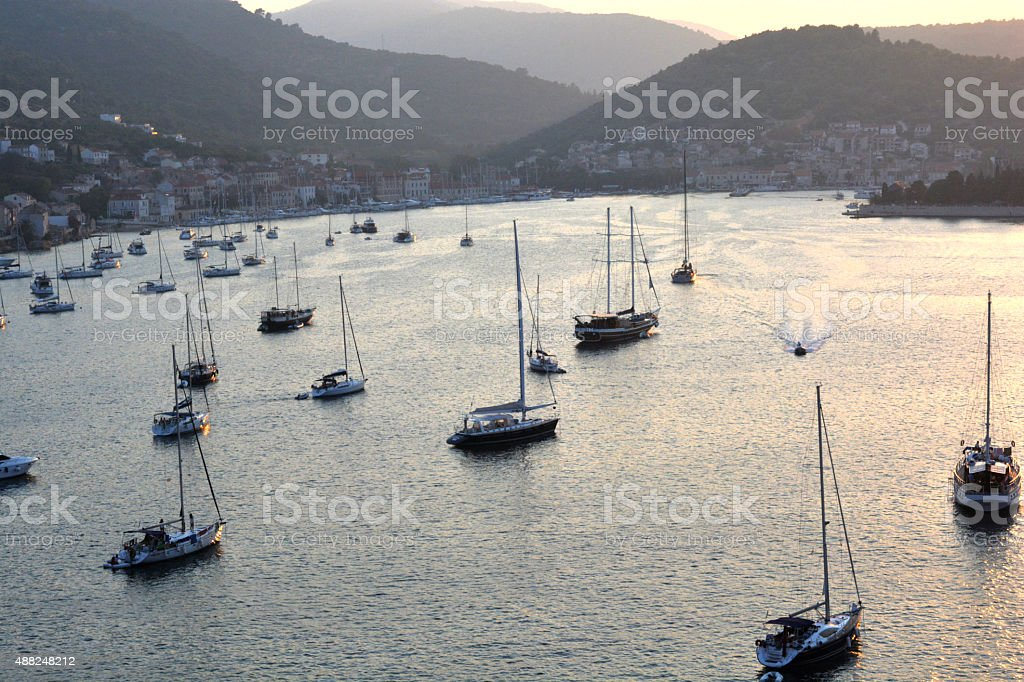 Yachts from above at sun set at the mediterranean coast stock photo