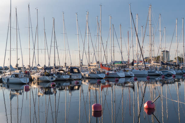 Yachts in Borgholm harbor in calm water in Sweden stock photo
