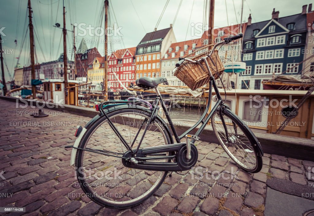COPENHAGEN - SEPTEMBER 07: Yachts in NYHAVN on September 07, 2014 in Copenhagen, Denmark. NYHAVN - favourite vacation spot of tourists and fans of a herring. stock photo
