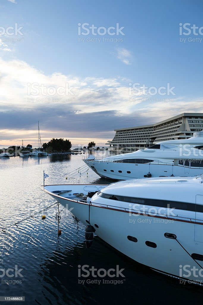 Yachts in the Marina. Sunset. Blue Moody Sky. royalty-free stock photo