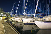 Lots of different yachts moored at the yacht port of Mallorca, Spain at nighttime