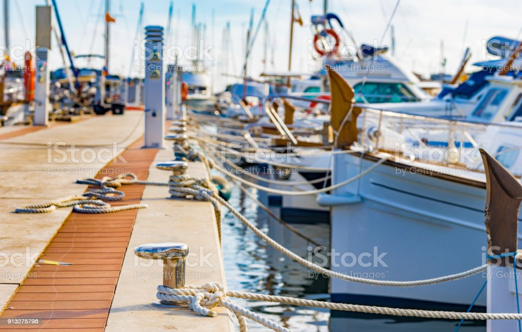 Yachts moored on harbour in Porto Colom on Majorca island, Spain Sailing boats moored at the pier in Portocolom on Mallorca, Spain Balearic islands Anchored Stock Photo