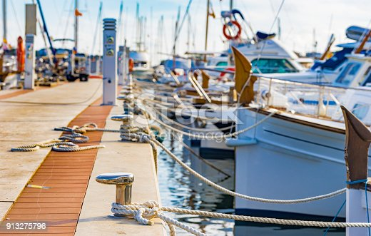 istock Yachts moored on harbour in Porto Colom on Majorca island, Spain 913275796