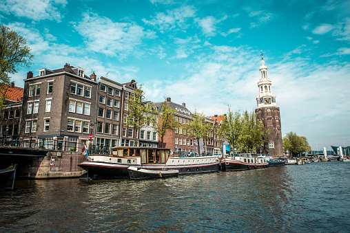 Yachts Near Montelbaanstoren Tower In Amsterdam, The Netherlands