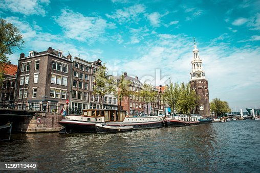 istock Yachts Near Montelbaanstoren Tower In Amsterdam, The Netherlands 1299119449