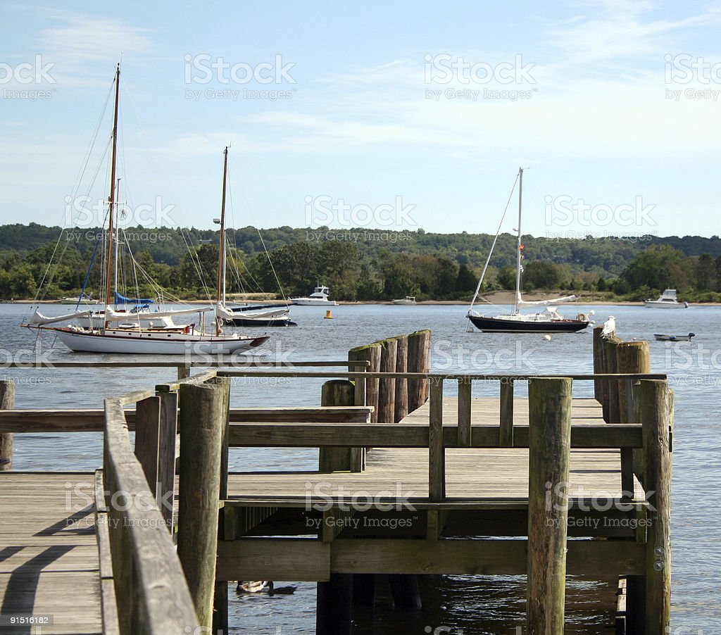 Yachts on mooring Pier Essex Harbor Connecticut River I stock photo