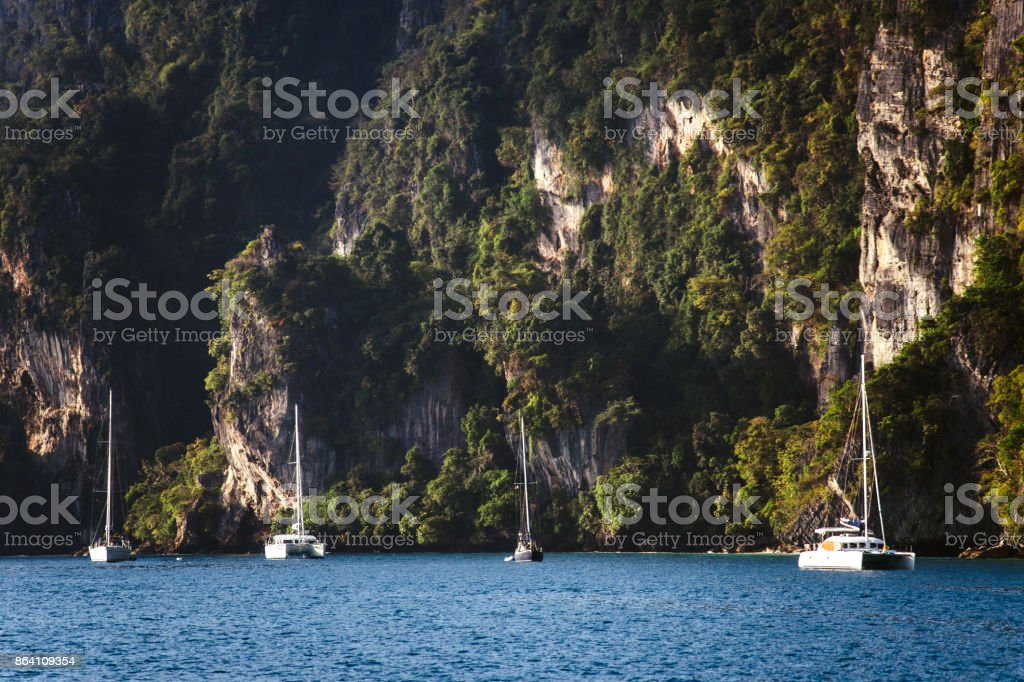 Yachts on the background of rocks royalty-free stock photo