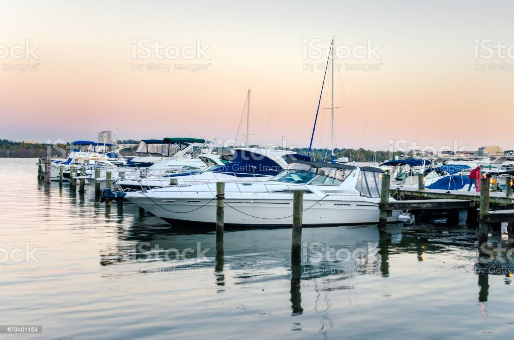 Yachts Tied up to a Jetty on the Potomac River at Dusk stock photo