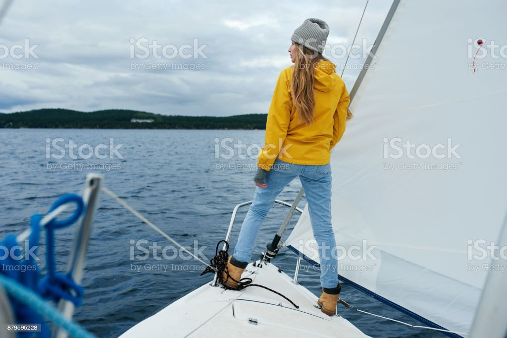 Yachtswoman sailing the boat stock photo