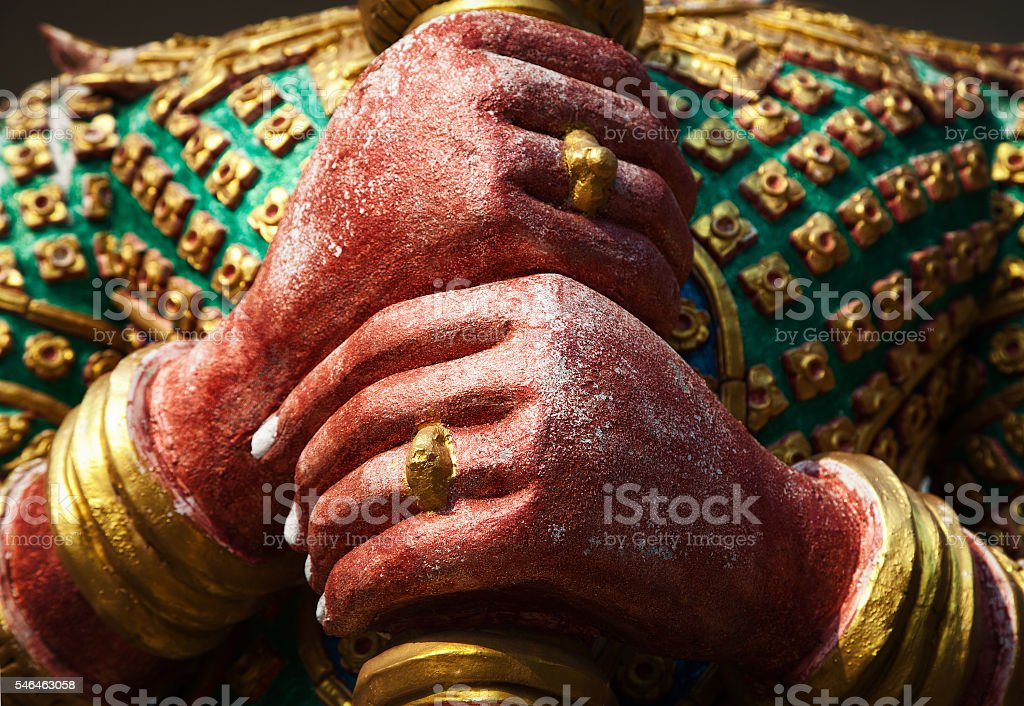 Yak guardian demon colorful sculpture hands close-up in Asian temple stock photo