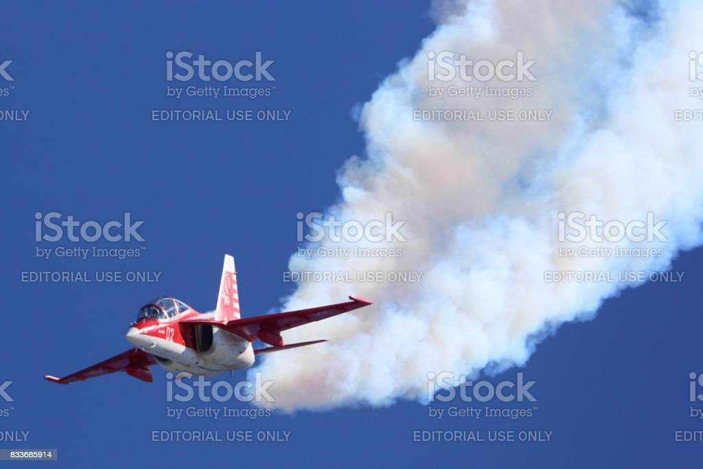 Yakovlev Yak-130 02 WHITE of russian air force perfoming demonstration flight in Zhukovsky during MAKS-2015 airshow. stock photo