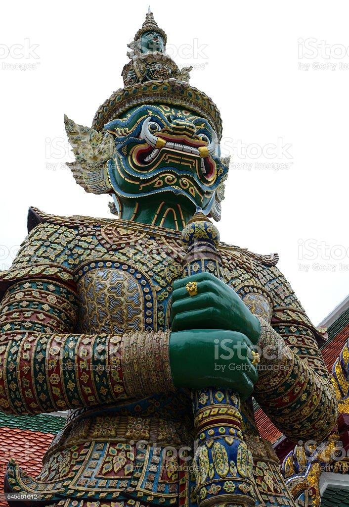 Yaksha demon guardian statue at historic Grand Palace in Bangkok stock photo