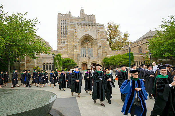 Yale University graduation ceremonies New Haven, USA - May 18, 2015: Yale University graduation ceremonies on Commencement Day on May 18, 2015. Yale University is a private Ivy League research university in New Haven, Connecticut. Founded in 1701 ivy league university stock pictures, royalty-free photos & images
