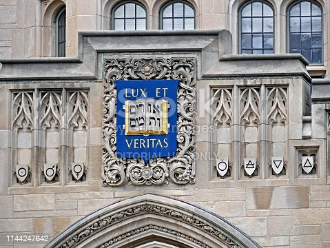 New Haven, CT, USA - June 25, 2015:  Yale University, ornate building facade with Hebrew and Latin mottos on crest