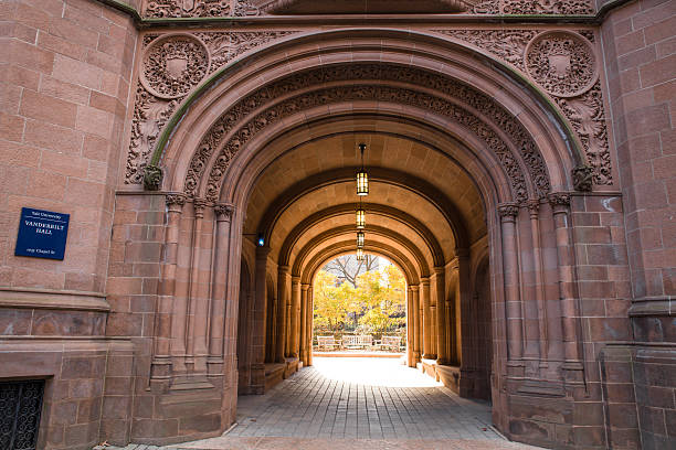 Yale University New Haven, Connecticut, USA - November 8, 2015:  View of Yale University at the arched gate at Vanderbilt Hall on an autumn day.  This is one of the entrances to the university's old campus.  ivy league university stock pictures, royalty-free photos & images