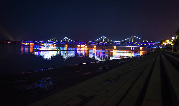 Yalu River Bridge in the night stock photo