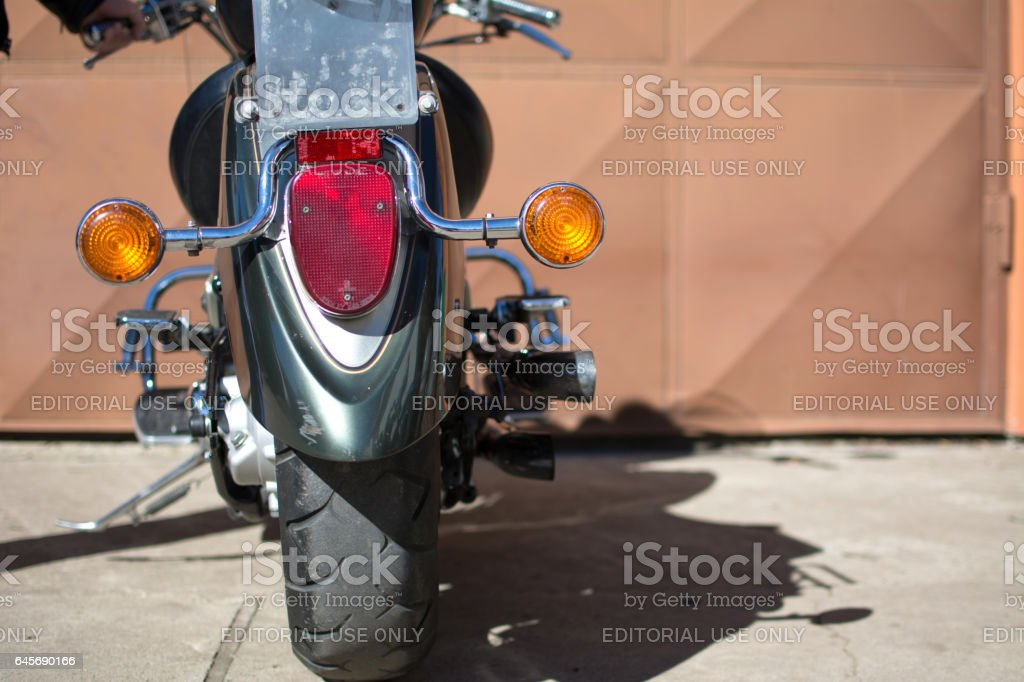 Yamaha DragStar motorcycle in front of the garage, photographed on a nice sunny day. stock photo